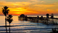 Oceanside Pier at sunset, clouds and palm trees with a brilliant sky at dusk. California, USA. Image #27612