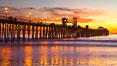 Oceanside Pier at sunset, clouds with a brilliant sky at dusk, the lights on the pier are lit. California, USA