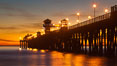 Oceanside Pier at sunset, clouds with a brilliant sky at dusk, the lights on the pier are lit. California, USA. Image #27618