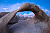 Mobius Arch at sunrise, framing snow dusted Lone Pine Peak and the Sierra Nevada Range in the background. Also known as Galen's Arch, Mobius Arch is found in the Alabama Hills Recreational Area near Lone Pine. Alabama Hills Recreational Area, California, USA. Image #27644