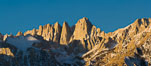 Mt. Whitney is the highest point in the contiguous United States with an elevation of 14,505 feet (4,421 m). It lies along the crest of the Sierra Nevada mountain range. Composed of the Sierra Nevada batholith granite formation, its eastern side (seen here) is quite steep. It is climbed by hundreds of hikers each year. Alabama Hills Recreational Area, California, USA. Image #27653