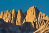 Mt. Whitney is the highest point in the contiguous United States with an elevation of 14,505 feet (4,421 m). It lies along the crest of the Sierra Nevada mountain range. Composed of the Sierra Nevada batholith granite formation, its eastern side (seen here) is quite steep. It is climbed by hundreds of hikers each year. Alabama Hills Recreational Area, California, USA. Image #27654