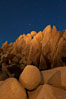 Boulders and stars, moonlight in Joshua Tree National Park. The moon gently lights unusual boulder formations at Jumbo Rocks in Joshua Tree National Park, California. Joshua Tree National Park, California, USA. Image #27716