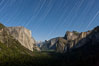 Star trails over Yosemite Valley, viewed from Tunnel View, the floor of Yosemite Valley illuminated by a full moon.  El Capitan on left, Bridalveil Falls on right, Half Dome in distant center. Yosemite National Park, California, USA