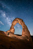 Delicate Arch and Milky Way, lit by quarter moon, hiker's flashlight and the fading blue sky one hour after sunset.  Arches National Park, Utah. Arches National Park, Utah, USA. Image #27855