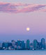 Blue Moon at Sunset over San Diego City Skyline.  The third full moon in a season, this rare