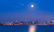 "Blue Moon at Sunset over San Diego City Skyline.  The third full moon in a season, this rare ""blue moon"" rises over San Diego just after sundown. California, USA. Image #28756"