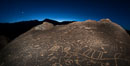 Sunset, planet Venus and stars over Sky Rock.  Sky Rock petroglyphs near Bishop, California. Hidden atop an enormous boulder in the Volcanic Tablelands lies Sky Rock, a set of petroglyphs that face the sky. These superb examples of native American petroglyph artwork are thought to be Paiute in origin, but little is known about them. USA. Image #28801