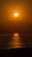Full Moon setting over the Pacific Ocean. Image #28867