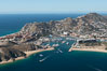 Cabo San Lucas, marina and downtown, showing extensive development and many resorts and sport fishing boats. Cabo San Lucas, Baja California, Mexico. Image #28899