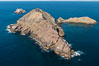 Middle Coronado Island, Mexico, looking north with San Diego and Point Loma in the distance, aerial photograph. Coronado Islands (Islas Coronado), Baja California. Image #29060