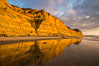 Torrey Pines cliffs and storm clouds at sunset. Torrey Pines State Reserve, San Diego, California, USA. Image #29102