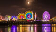 Full moon rising at night over the San Diego County Fair.  Del Mar Fair at night. California, USA