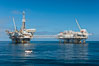 Oil platforms Ellen (left) and Elly (right) lie in 260' of seawater 8.5 miles off Long Beach, California. Long Beach, California, USA. Image #31095