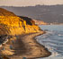Torrey Pines State Beach at Sunset, La Jolla, Mount Soledad and Blacks Beach in the distance. Torrey Pines State Reserve, San Diego, California, USA. Image #35847