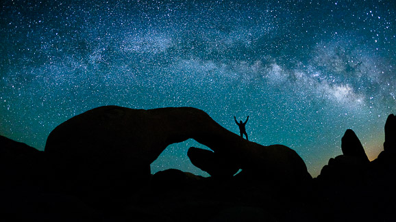 Self-portrait below the Milky Way in Joshua Tree National Park, California.