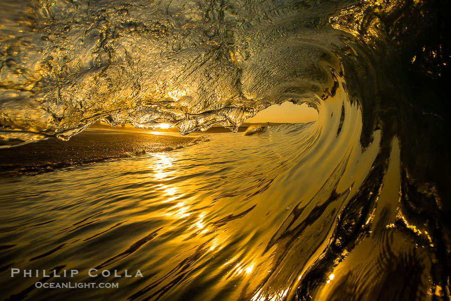 Sunrise breaking wave, dawn surf, The Wedge, Newport Beach, California