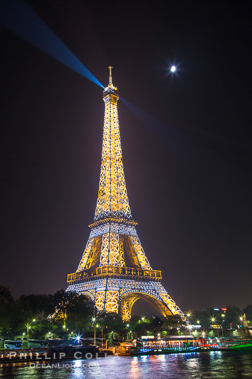 River Seine, Full Moon and Eiffel Tower at night, Paris. La Tour Eiffel. The Eiffel Tower is an iron lattice tower located on the Champ de Mars in Paris, named after the engineer Gustave Eiffel, who designed the tower in 1889 as the entrance arch to the 1889 World's Fair. The Eiffel tower is the tallest structure in Paris and the most-visited paid monument in the world