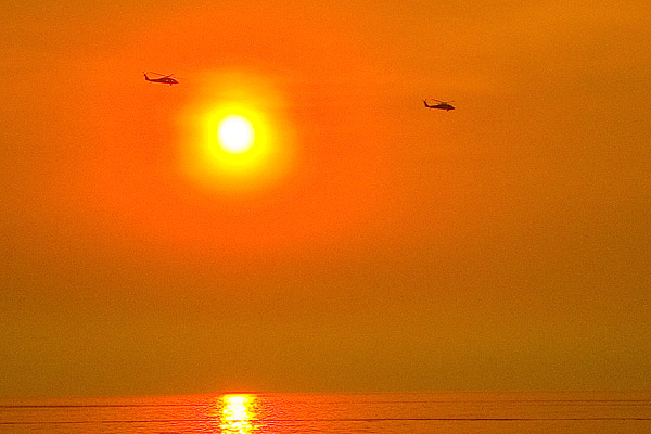 Choppers over Ponto at sunset