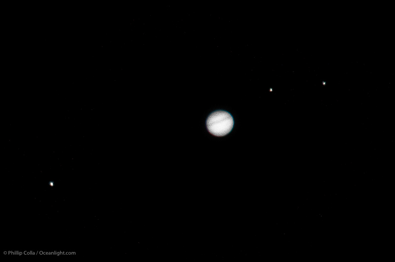 Jupiter and moons Europa, Callisto and Ganymede (R to L)