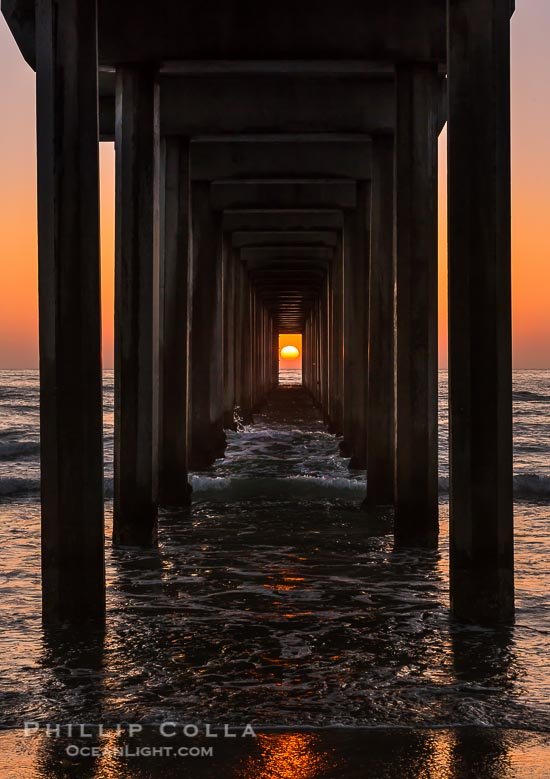 Scripps Pier Sunset Solar Alignment, the setting sun is framed perfectly within the pilings of Scripps Institution of Oceanography research pier, a rare event.