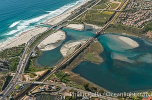 Aerial photo of Batiquitos Lagoon, Carlsbad. The Batiquitos Lagoon is a coastal wetland in southern Carlsbad, California. Part of the lagoon is designated as the Batiquitos Lagoon State Marine Conservation Area, run by the California Department of Fish and Game as a nature reserve. Carlsbad, Callifornia, USA, natural history stock photograph, photo id 30571