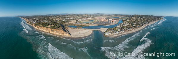 Aerial Panoramic Photo of Del Mar Dog Beach and San Dieguito River. To the left (north) is Solana Beach, to the right (south) is Del Mar with La Jolla's Mount Soledad in the distance.  Beyond the San Dieguito River mouth in the center is the Del Mar Racetrack