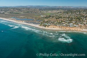 Aerial Photo of San Elijo Lagoon and Cardiff Reef beach. San Elijo Lagoon Ecological Reserve is one of the largest remaining coastal wetlands in San Diego County, California, on the border of Encinitas, Solana Beach and Rancho Santa Fe