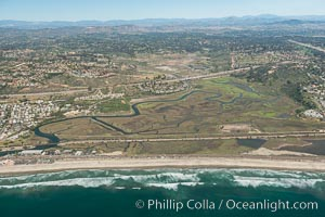 Aerial Photo of San Elijo Lagoon. San Elijo Lagoon Ecological Reserve is one of the largest remaining coastal wetlands in San Diego County, California, on the border of Encinitas, Solana Beach and Rancho Santa Fe. Encinitas, California, USA, natural history stock photograph, photo id 30618