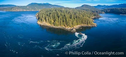 Seymour Narrows with strong tidal currents.  Between Vancouver Island and Quadra Island, Seymour Narrows is about 750 meters wide and has currents reaching 15 knots.  Aerial photo