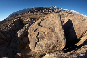 The Alabama Hills, with characteristic curious eroded rock formations formed of ancient granite and metamorphosed rock, next to the Sierra Nevada mountains and the town of Lone Pine, Alabama Hills Recreational Area