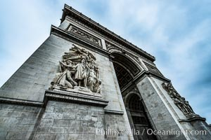 "Arc de Triomphe. The Arc de Triomphe (Arc de Triomphe de l'Etoile) is one of the most famous monuments in Paris. It stands in the centre of the Place Charles de Gaulle (originally named Place de l'Etoile), at the western end of the Champs-Elysees. The Arc de Triomphe (in English: ""Triumphal Arch"") honors those who fought and died for France in the French Revolutionary and the Napoleonic Wars, with the names of all French victories and generals inscribed on its inner and outer surfaces. Beneath its vault lies the Tomb of the Unknown Soldier from World War I. The monument was designed by Jean Chalgrin in 1806, and its iconographic program pitted heroically nude French youths against bearded Germanic warriors in chain mail. It set the tone for public monuments, with triumphant patriotic messages. The monument stands 50 metres (164 ft) in height, 45 m (148 ft) wide and 22 m (72 ft) deep. Arc de Triomphe, Paris, France, natural history stock photograph, photo id 28083"