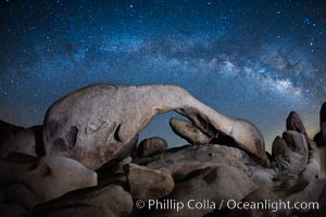 The Milky Way galaxy above Arch Rock, Joshua Tree National Park, night star field exposure. Joshua Tree National Park, California, USA, natural history stock photograph, photo id 26862