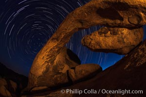 Arch Rock and star trails, impending dawn, Joshua Tree National Park, California