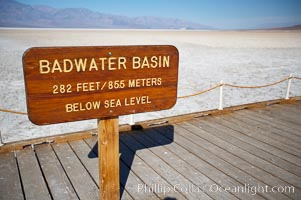 Badwater, California.  Badwater, at 282 feet below sea level, is the lowest point in North America.  9000 square miles of watershed drain into the Badwater basin, to dry and form huge white salt flats.,  Copyright Phillip Colla, image #15580, all rights reserved worldwide.