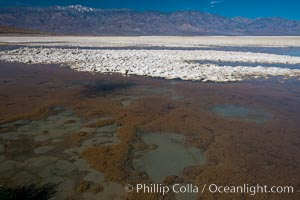 Badwater, California.  Badwater, at 282 feet below sea level, is the lowest point in North America.  9000 square miles of watershed drain into the Badwater basin, to dry and form huge white salt flats.,  Copyright Phillip Colla, image #15595, all rights reserved worldwide.