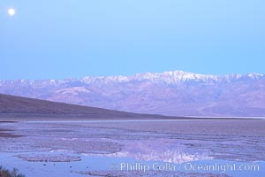 Sunrise lights Telescope Peak as it rises over the salt flats of Badwater, Death Valley.  At 11,049 feet, Telescope Peak is the highest peak in the Panamint Range as well as the highest point in Death Valley National Park.  At 282 feet below sea level, Badwater is the lowest point in North America