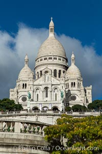 Sacre-Coeur Basilica.  The Basilica of the Sacred Heart of Paris, commonly known as Sacre-Coeur Basilica, is a Roman Catholic church and minor basilica, dedicated to the Sacred Heart of Jesus, in Paris, France. A popular landmark, the basilica is located at the summit of the butte Montmartre, the highest point in the city. Basilique du Sacre-Coeur, Paris, France, natural history stock photograph, photo id 28154