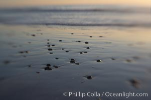 Beach stones and wet sand, reflections of sunset, Ponto, Carlsbad, California
