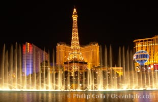 The Bellagio Hotel fountains light up the reflection pool as the half-scale replica of the Eiffel Tower at the Paris Hotel in Las Vegas rises above them, at night. Las Vegas, Nevada, USA, natural history stock photograph, photo id 20559