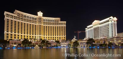 The Bellagio Hotel (left) and Caesar&#39;s Palace (right) reflected in the fountain pool, at night.  The Bellagio Hotel fountains are one of the most popular attractions in Las Vegas, showing every half hour or so throughout the day, choreographed to famous Hollywood music