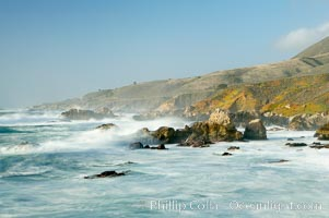 Waves blur as they break over the rocky shoreline of Big Sur