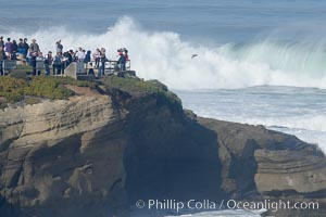 People watch giant surf breaking at Boomers / Alligator Head near La Jolla Cove.  Giant surf and big waves nail Southern California, December 21, 2005