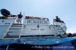 Crew of the dive boat Horizon wait at the stern to help divers out of the water, Guadalupe Island (Isla Guadalupe)