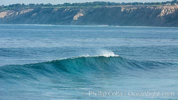 Boomer Beach wave, winter swell, La Jolla, Black's Beach and Torrey Pines in the distance
