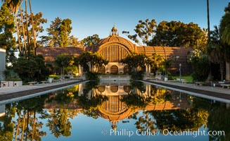 The Botanical Building in Balboa Park, San Diego. The Botanical Building, at 250 feet long by 75 feet wide and 60 feet tall, was the largest wood lath structure in the world when it was built in 1915 for the Panama-California Exposition. The Botanical Building, located on the Prado, west of the Museum of Art, contains about 2,100 permanent tropical plants along with changing seasonal flowers. The Lily Pond, just south of the Botanical Building, is an eloquent example of the use of reflecting pools to enhance architecture. The 193' by 43' foot pond and smaller companion pool were originally referred to as Las Lagunas de las Flores (The Lakes of the Flowers) and were designed as aquatic gardens. The pools contain exotic water lilies and lotus which bloom spring through fall. Balboa Park, San Diego, California, USA, natural history stock photograph, photo id 28824