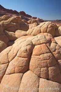 Brain rocks.  Sandstone is curiously eroded through the forces water and wind acting over eons.  Cracks and joints arise when water freezes and expands repeatedly, braking apart the soft sandstone, North Coyote Buttes, Paria Canyon-Vermilion Cliffs Wilderness, Arizona