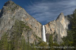 Bridalveil Falls drops 620 through a hanging valley, shown here at peak water flow in spring months from deep snowpack and warm weather melt.  Yosemite Valley, Yosemite National Park, California