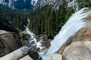 Vernal Falls cascades down through Little Yosemite Valley.  The Merced River is seen far below.  Yosemite National Park, Spring