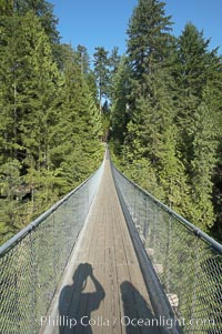 Capilano Suspension Bridge, 140 m (450 ft) long and hanging 70 m (230 ft) above the Capilano River.  The two pre-stressed steel cables supporting the bridge are each capable of supporting 45,000 kgs and together can hold about 1300 people, Vancouver, British Columbia, Canada